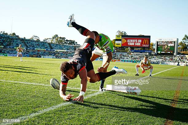 Manu Vatuvei of the Warriors dives to score a try during the round 20 NRL match between the Canberra Raiders and the New Zealand Warriors at GIO...