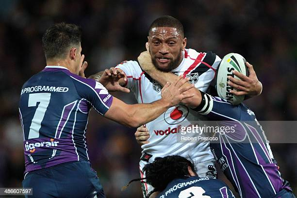 Manu Vatuvei of the Warriors is tackled by Cooper Cronk of the Storm during the round 8 NRL match between the Melbourne Storm and the New Zealand...