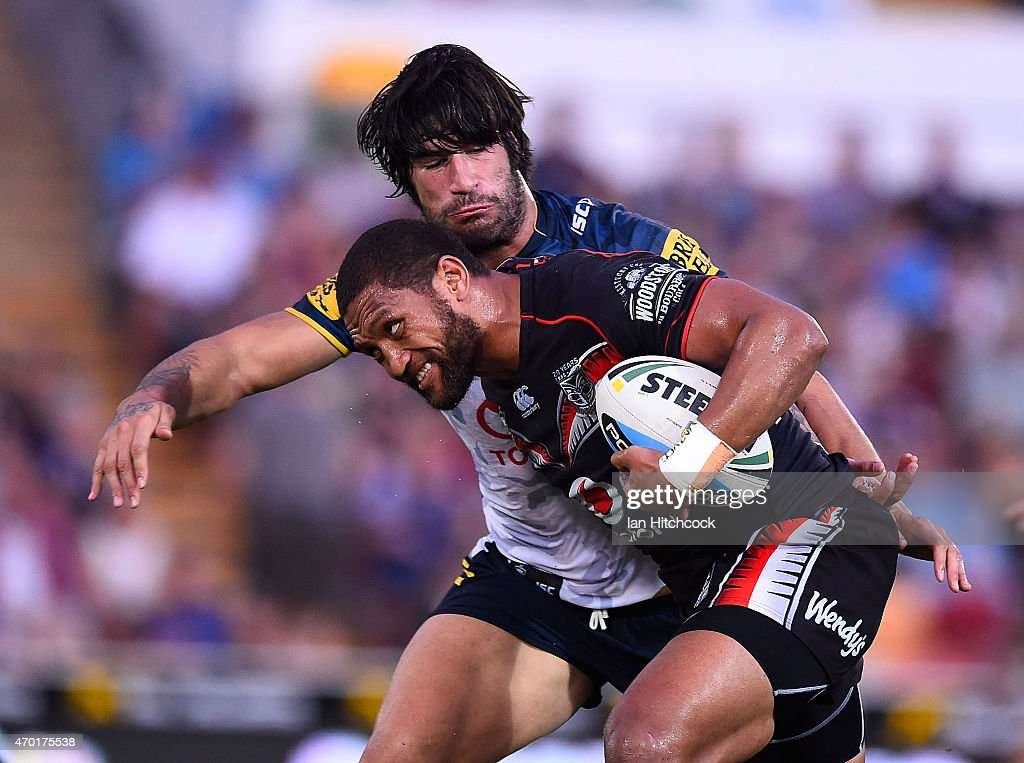 Manu Vatuvei of the Warriors is tackled by James Tamou of the Cowboys during the round seven NRL match between the North Queensland Cowboys and the New Zealand Warriors at 1300SMILES Stadium on April 18, 2015 in Townsville, Australia.