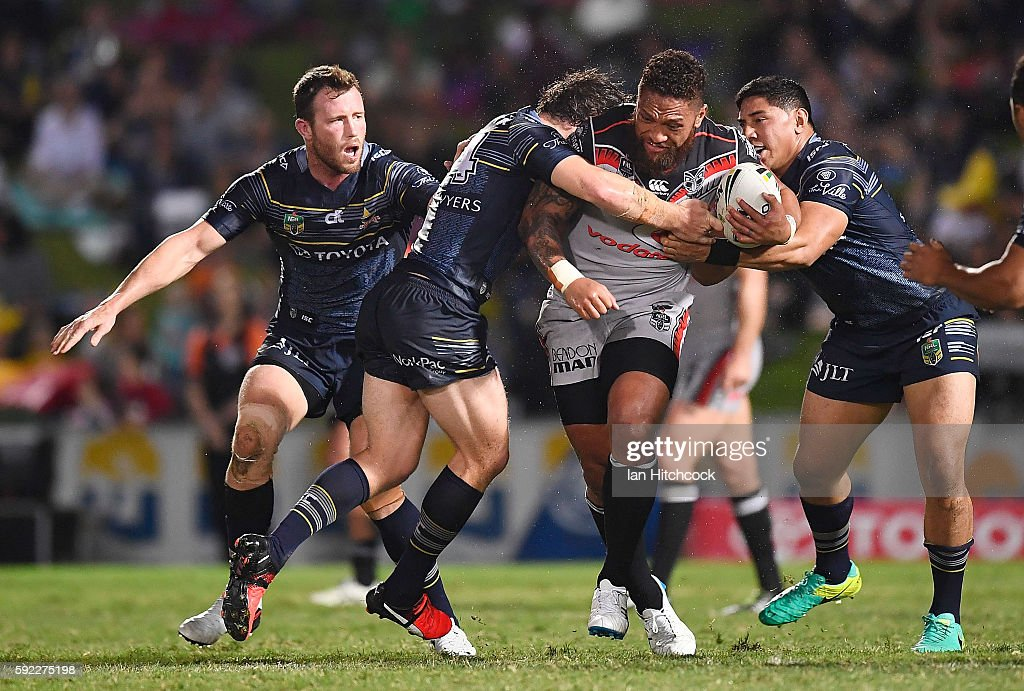 Manu Vatuvei of the Warriors is tackled by Jason Taumalolo and Rory Kostjasyn of the Cowboys during the round 24 NRL match between the North Queensland Cowboys and the New Zealand Warriors at 1300SMILES Stadium on August 20, 2016 in Townsville, Australia.