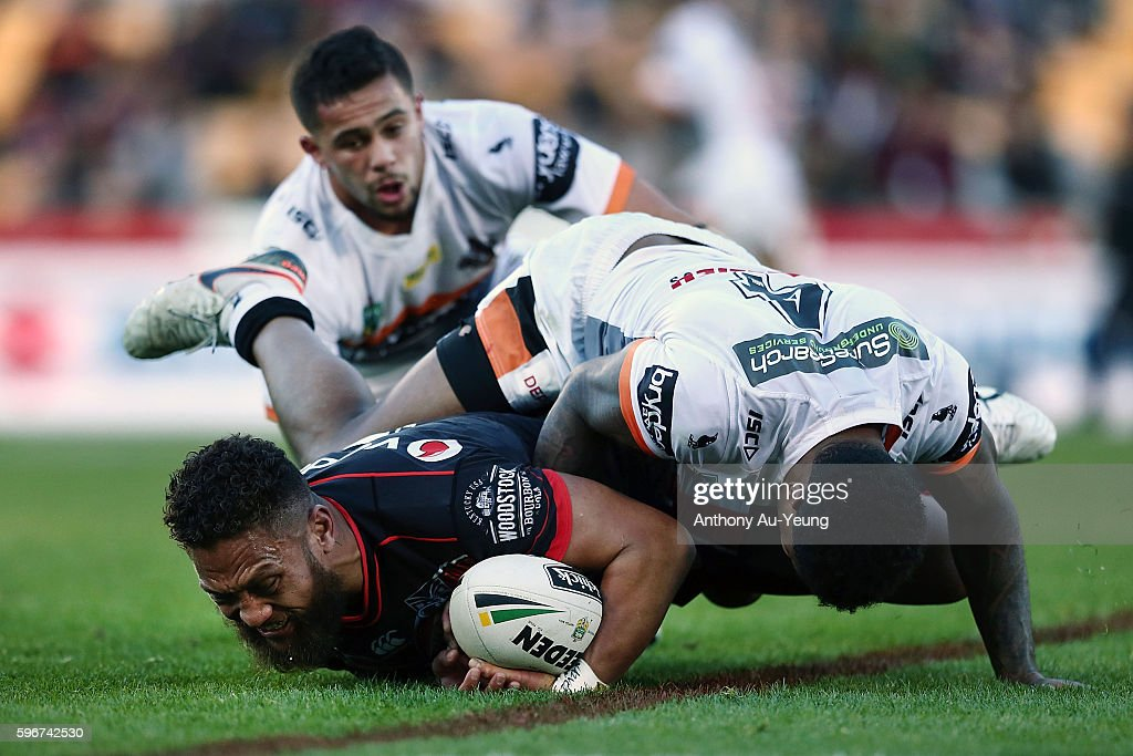 Manu Vatuvei of the Warriors is tackled by Kevin Naiqama of the Tigers during the round 25 NRL match between the New Zealand Warriors and the Wests Tigers at Mount Smart Stadium on August 28, 2016 in Auckland, New Zealand.