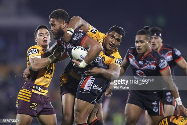 Manu Vatuvei of the Warriors is tackled by Tevita Pangai Junior of the Broncos during the round 13 NRL match between the New Zealand Warriors and the...
