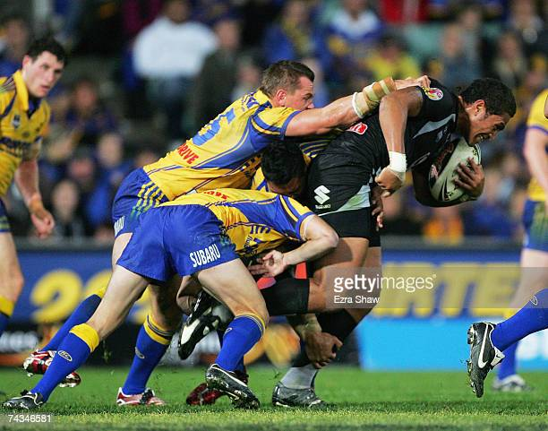 Manu Vatuvei of the Warriors is tackled by the Eels during the round 11 NRL match between the Parramatta Eels and the Warriors at Parramatta Stadium...