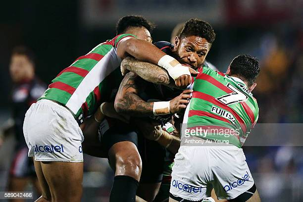 Manu Vatuvei of the Warriors on the charge against Adam Reynolds of the Rabbitohs during the round 23 NRL match between the New Zealand Warriors and...
