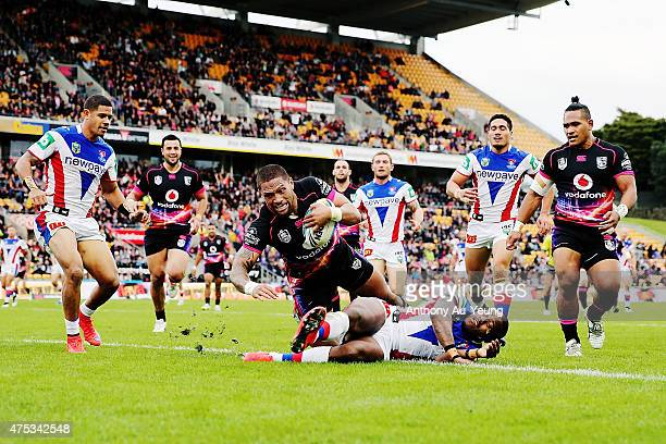 Manu Vatuvei of the Warriors scores a try during the round 12 NRL match between the New Zealand Warriors and the Newcastle Knights at Mt Smart...