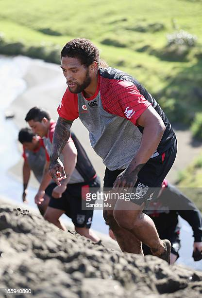 Manu Vatuvei of the Warriors trains on the sand dunes during the New Zealand Warriors NRL training session at Bethells Beach on November 10 2012 in...