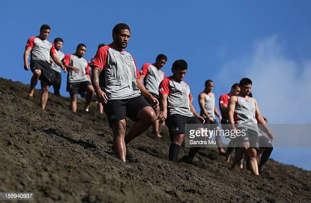 Manu Vatuvei of the Warriors trains on the sand dunes with the team during the New Zealand Warriors NRL training session at Bethells Beach on...