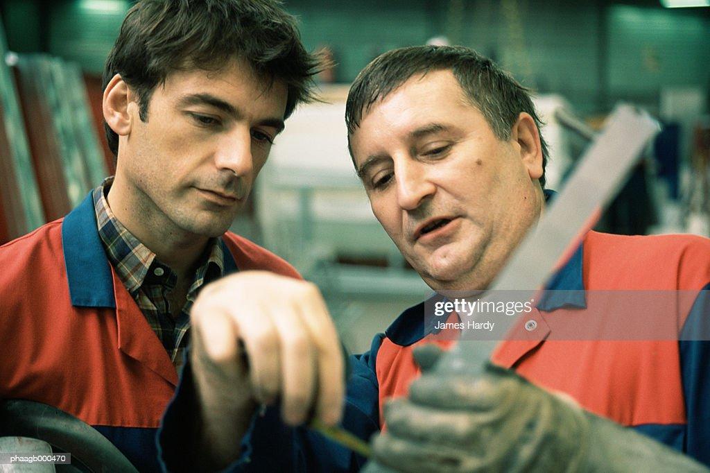 Manual and apprentice : Stockfoto