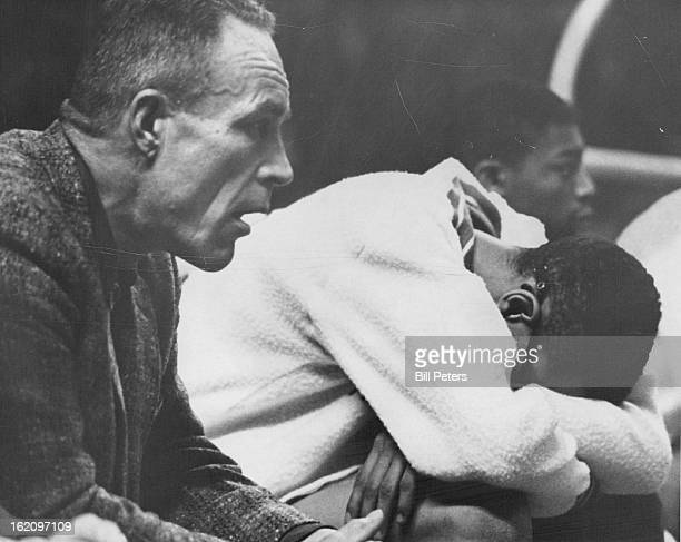 MAR 24 1962 MAR 26 1962 Manual Coach Player Despair It's not hard to figure what's happening from the expression on Coach Al Oviatt's face and the...
