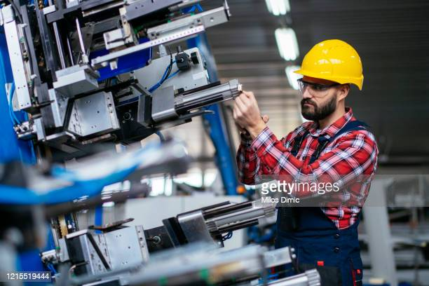 manual factory worker stock photo - accuracy stock pictures, royalty-free photos & images