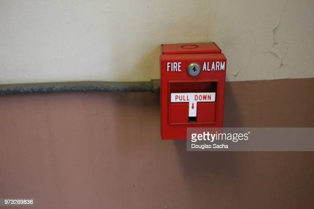 Manual fire alarm activation pull station on a interior wall