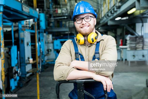 manual worker at modern factory - manufacturing equipment stock pictures, royalty-free photos & images
