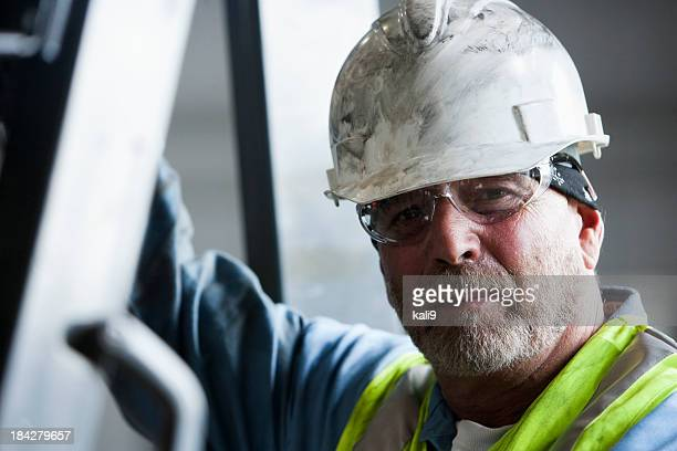 Manual worker in hard hat and safety glasses
