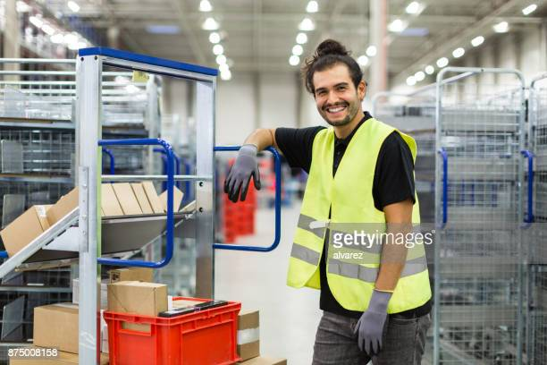 manual worker in large distribution warehouse - shipping stock pictures, royalty-free photos & images