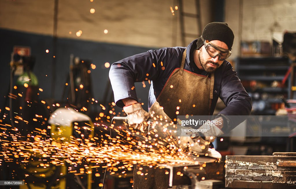 manual worker on a workshop : Stock Photo