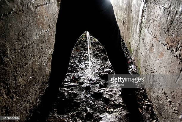 manual worker peeing - dark gloomy dungeon of despair