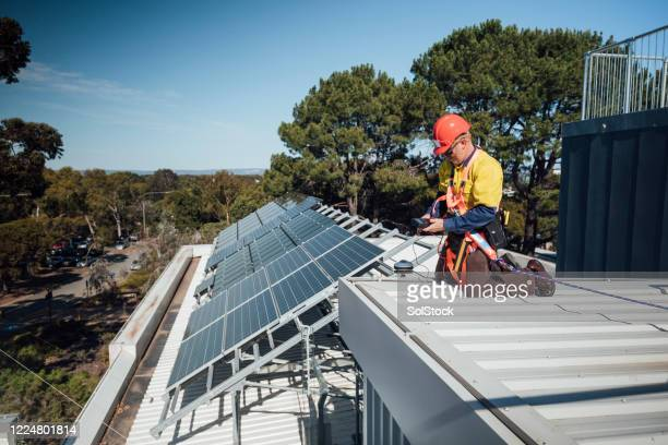 manual worker - solar energy stock pictures, royalty-free photos & images