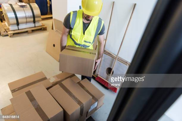manual worker - picking up stock pictures, royalty-free photos & images