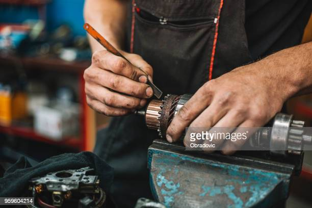 manual worker repairing electric motor in a workshop - electric motor stock photos and pictures