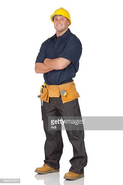 Arbeiter stehend mit Arme verschränkt
