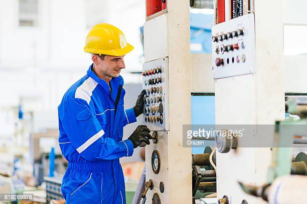 Manual worker starting  production line in factory
