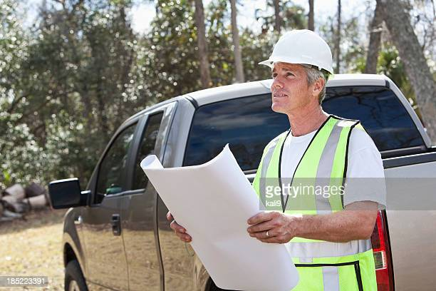 Manual worker wearing hardhat and safety vest