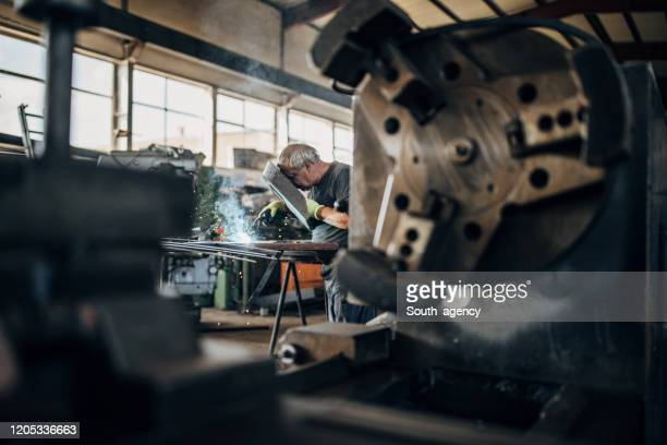 manual worker welding - in flames i the mask stock pictures, royalty-free photos & images