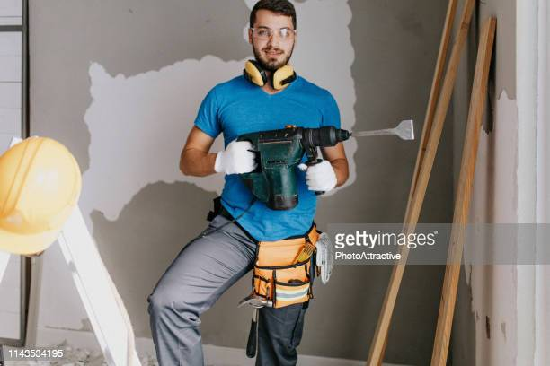 manual worker with a drill - masculinity stock pictures, royalty-free photos & images
