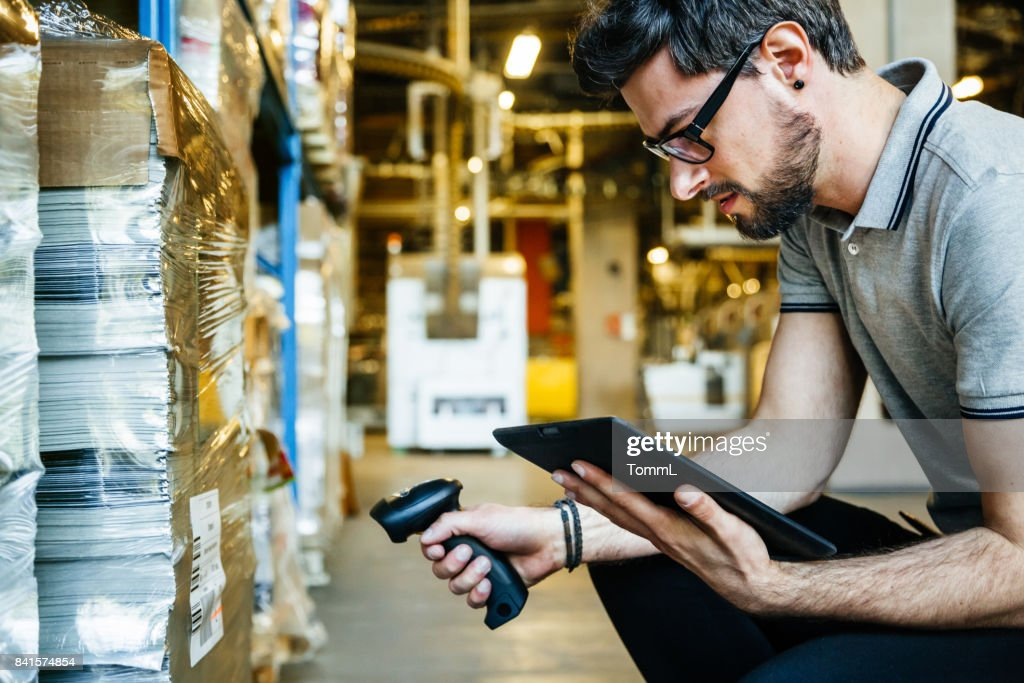 Manual Worker With Bar Code Reader And Digital Tablet : Stock Photo