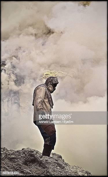 Manual Worker With Safety Mask In Dusty Environment