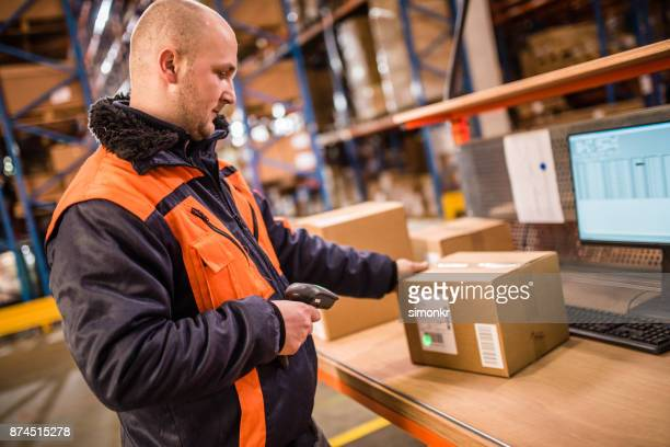 manual worker working in warehouse - heavy industry stock photos and pictures
