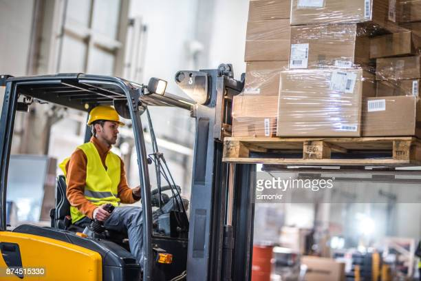 Manual worker working in warehouse