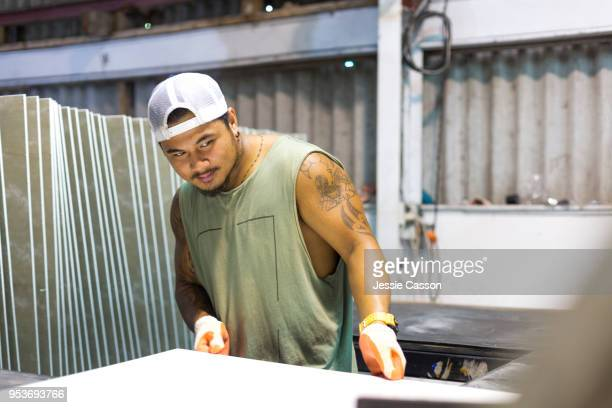 A manual worker works in a factory warehouse