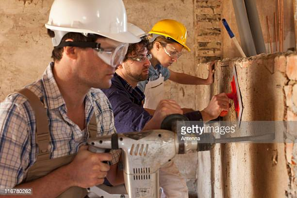 Manual workers working at a building site