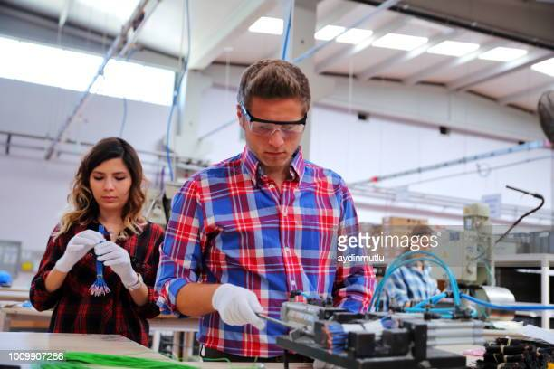 manual workers working at a factory - molding a shape stock pictures, royalty-free photos & images