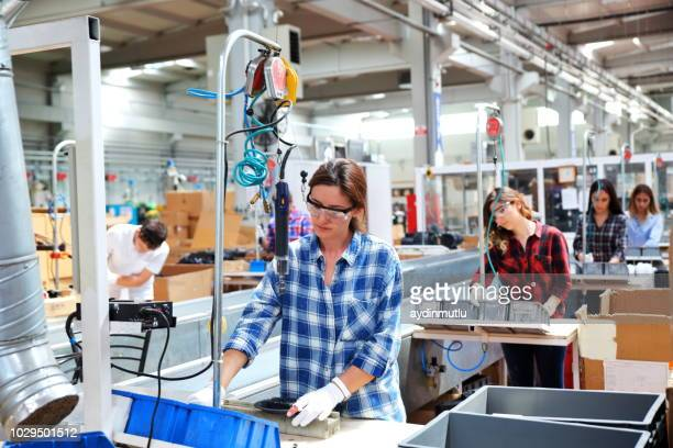 manual workers working at a factory - production line stock pictures, royalty-free photos & images