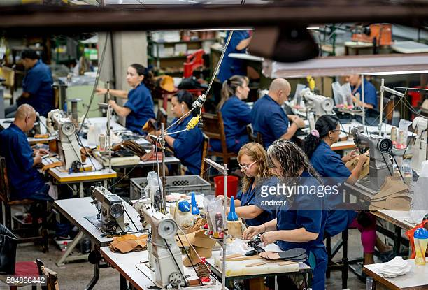manual workers working at a factory - textile industry stock pictures, royalty-free photos & images