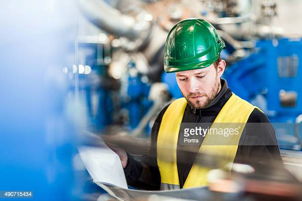 Manual working reading document in factory