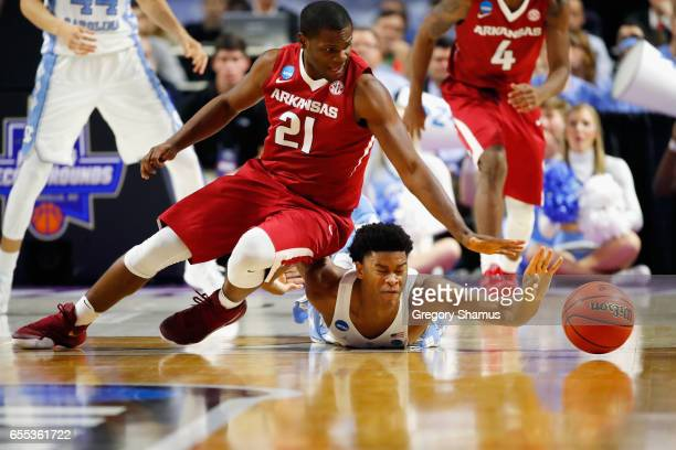 Manuale Watkins of the Arkansas Razorbacks battles for a loose ball with Isaiah Hicks of the North Carolina Tar Heels in the second half during the...