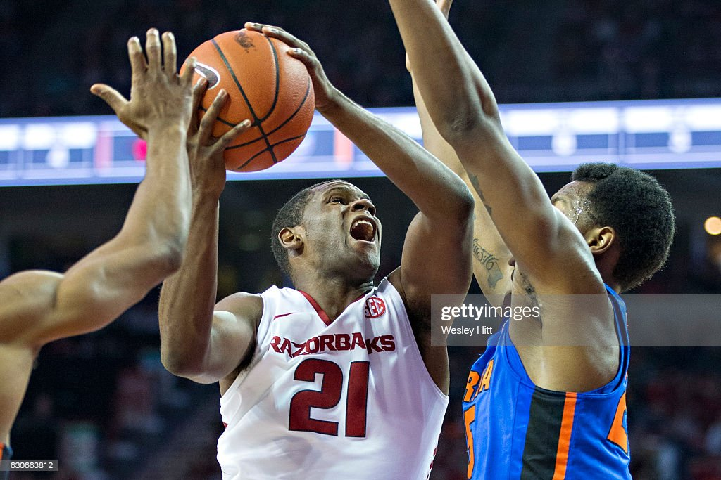 Manuale Watkins #21 of the Arkansas Razorbacks drives to the basket during a game against the Florida Gators at Bud Walton Arena on December 29, 2016 in Fayetteville, Arkansas. The Gators defeated the Razorbacks 81-72.