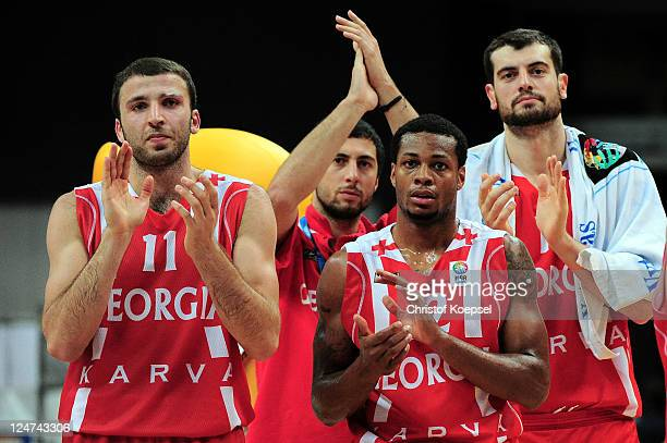 Manuchar Markoishbili Marquez Haynes and Giorgi Gamqrelidze of Georgia look dejected after losing 6073 the EuroBasket 2011 second round group F match...