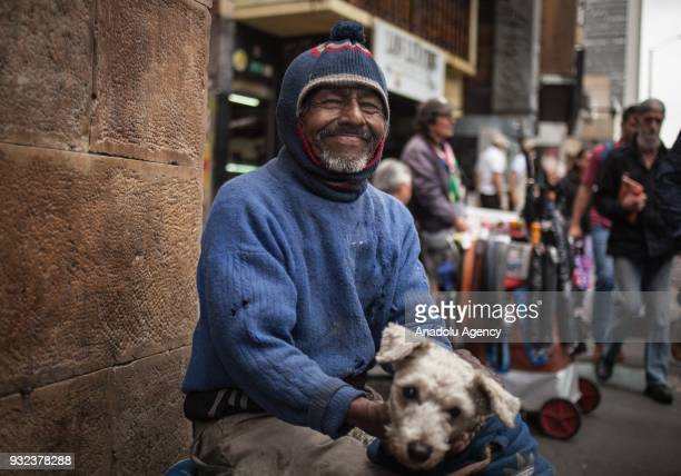 Manuel a 55yearold homeless day laborer gestures with his dog Mueca in Bogota Colombia on March 10 2018 Manuel sleeps on a sidewalk Manuel said he...