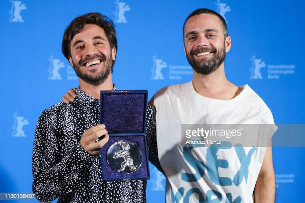 Manuel Abramovich winner of the Silver Bear Jury Prize for 'Blue Boy' and Creative Producer Bogdan Georgescu pose backstage at the closing ceremony...