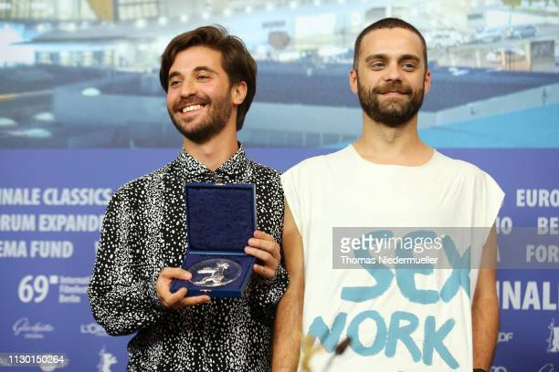 Manuel Abramovich winner of the Silver Bear Jury Prize for 'Blue Boy' and Creative Producer Bogdan Georgescu pose at the press conference after the...