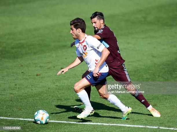 Manuel Agudo 'Nolito' of Celta Vigo and Nacho Vidal of Osasuna battle for the ball during the Liga match between CA Osasuna and RC Celta de Vigo at...