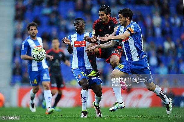 Manuel Agudo 'Nolito' of RC Celta de Vigo competes for the ball with Pape Diop and Javi Lopez of RCD Espanyol during the La Liga match between Real...