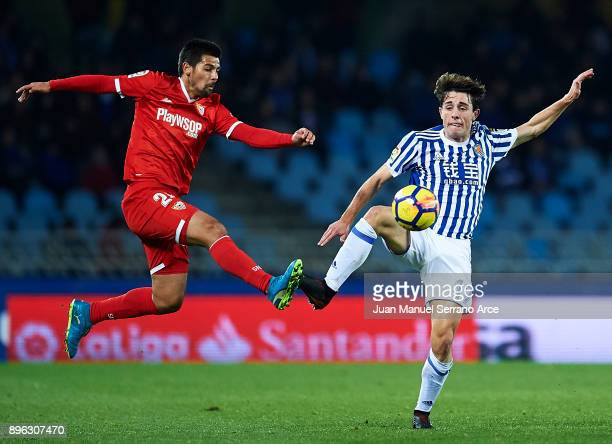 Manuel Agudo 'Nolito' of Sevilla FC competes for the ball with Alvaro Odriozola of Real Sociedad during the La Liga match between Real Sociedad and...