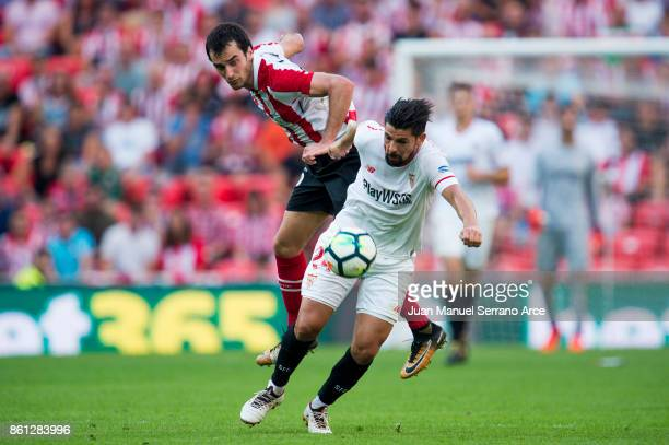 Manuel Agudo 'Nolito' of Sevilla FC competes for the ball with Inigo Lekue of Athletic Club during the La Liga match between Athletic Club Bilbao and...