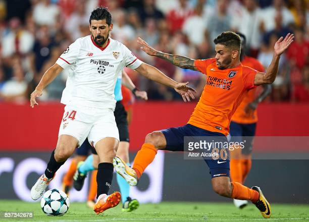 """Manuel Agudo """"Nolito"""" of Sevilla FC competes for the ball with Junior Caicara of Istanbul Basaksehir during the UEFA Champions League Qualifying..."""
