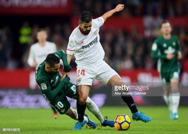 Manuel Agudo 'Nolito' of Sevilla FC duels for the ball with Ryad Boudebouz of Real Betis during the La Liga match between Sevilla FC and Real Betis...